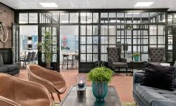 Hemmakänsla med en twist av engelsk pub på Fastighetsbyråns Hisingenkontor